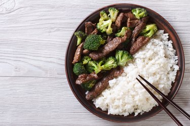 beef with broccoli and rice on the table. top view