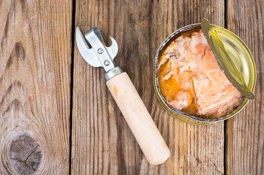 Canned fish salmon or tuna in open metal can