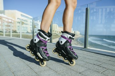 Close-up of woman's legs with inline skates