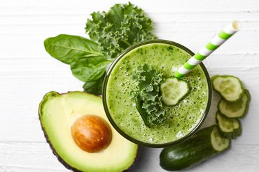 Glass of green vegetable smoothie