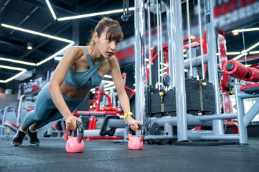 Strong woman pushups exercise in the fitness gym