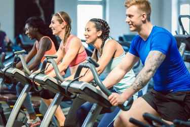 People doing cycling workout to get the benefits of HIIT