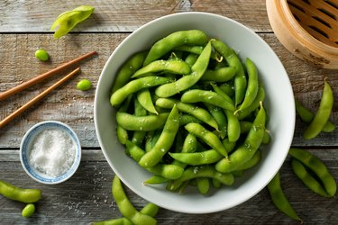Choline-rich edamame in bowl on wooden table