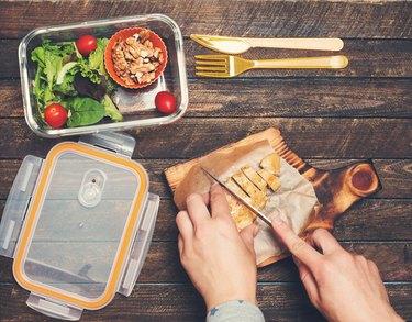 Woman preparing takeaway meal for a 1200-calorie diet plan