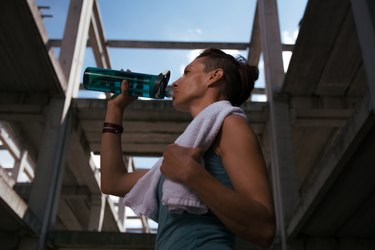 Girl drinking water after exercising