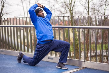 Runner doing a hip stretch outside