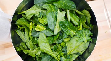 Photography of cup with spinach