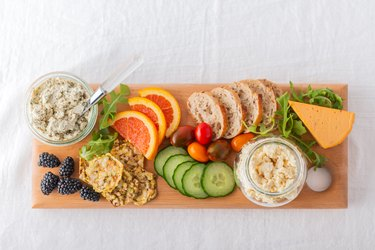 Healthy Vegan Cheese, Fruit, Vegetable, Crackers, Bread on Recycled Board
