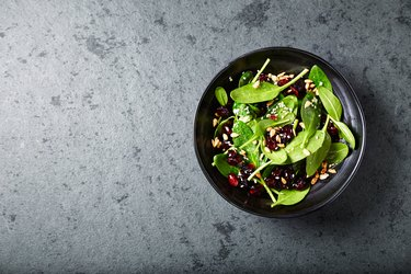 Spinach salad with dried cranberries and pomegranate seeds