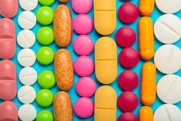 Colorful vitamins on a blue background