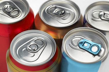 Cola soda fizzy drinks cans