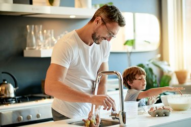 Man and child baking in the kitchen