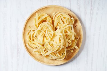 Fresh, uncooked dried pasta on a plate