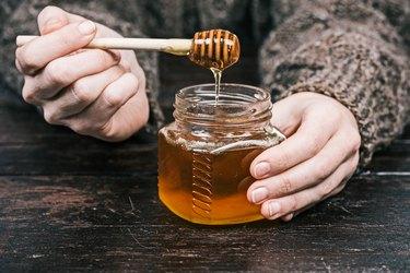Hands holding honey