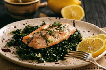 Baked salmon served on stewed spinach with lemon butter sauce.