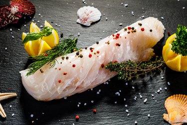 Fresh raw Haddock fillets on cutting board