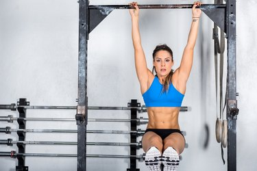 Cross training & woman on gymnastic bar