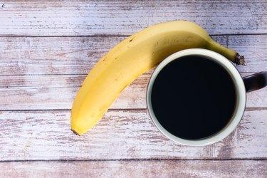 Coffee and banana on table