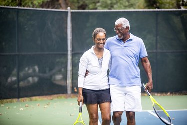 Senior Black Couple on Tennis Court