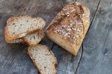 healthy grain bread on a wooden table