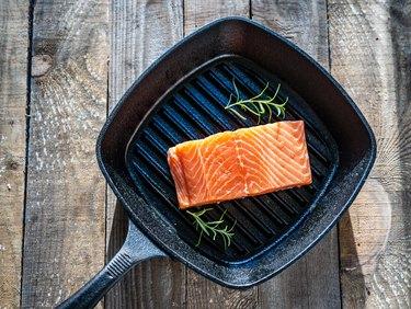 Fresh raw salmon steak on cooking pan
