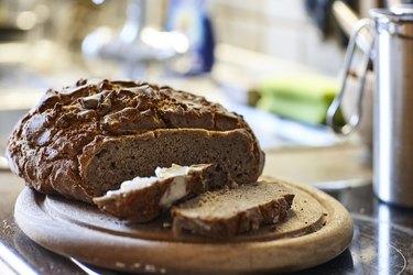 Rye bread sitting on cutting board.