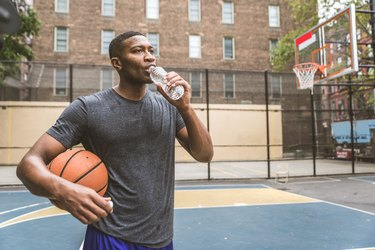 Basketball player training outdoors