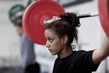 Young woman training with weights