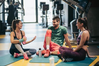 Group of people discussing workout.