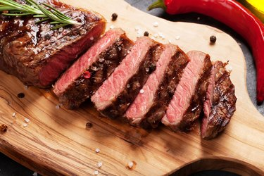 Grilled choline-rich steak on table