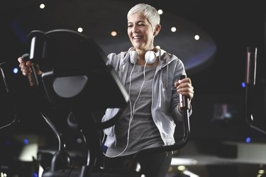 Senior woman exercising at the gym