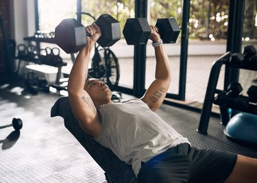 Man performing chest press.