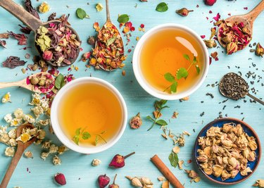 Two cups of healthy herbal tea with mint, cinnamon, dried