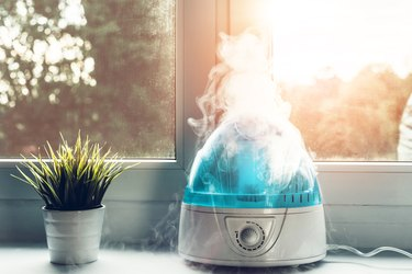 An air humidifier running on a windowsill, as a natural remedy for cough