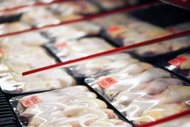 Refrigerated chicken legs in store marked for recall
