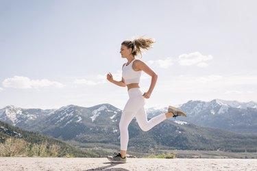 Young woman running in mountain setting