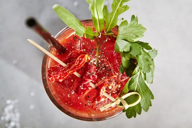 Bloody Mary Cocktail over Gray Background