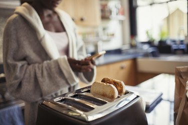 A woman making toast in her kitchen