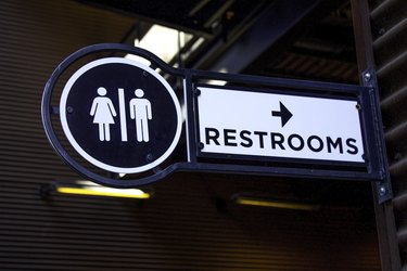 A close-up view of a restroom sign