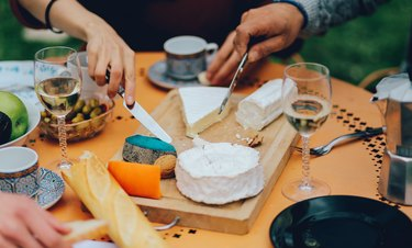low-fat cheeses friends eating cheese board