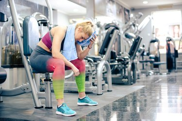 Girl at gym, having break