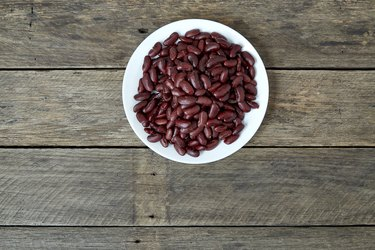 Directly Above Shot Of Kidney Beans In Plate On Wooden Table