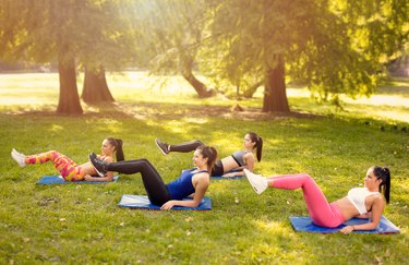 Young Women Exercising In Nature