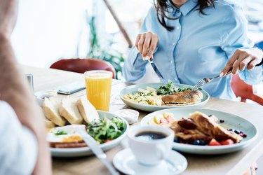 Couple having healthy breakfast in modern restaurant