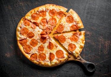 Crispy pepperoni pizza on the cutting Board.
