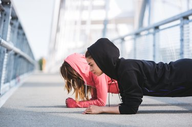 Young women friends working out together