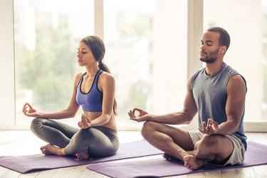 African-American couple doing yoga