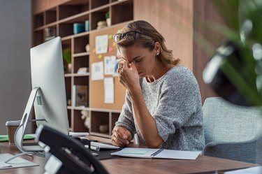 Business woman having headache at office