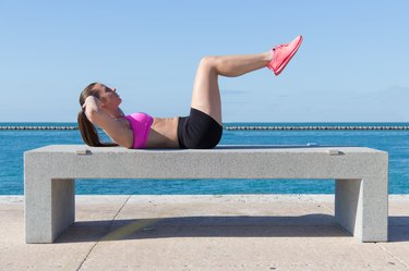 Woman doing ab crunches for fitness