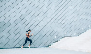 Woman is running on the city stairs